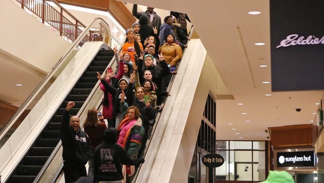 Protesters of the grand jury decision in the Michael Brown shooting chant slogans at Galleria mall on Nov. 26 in Richmond Heights, Mo.