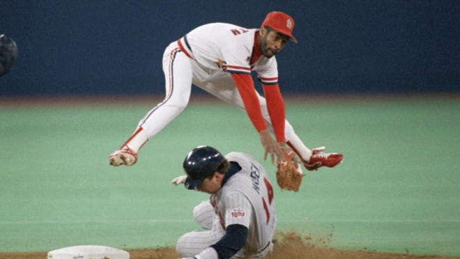Former St. Louis Cardinals shortstop Ozzie Smith leaps over the Minnesota Twins' Kent Hrbek in the sixth inning of Game 4 of the World Series at St. Louis on Oct. 22, 1987.