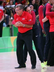 Diana Taurasi celebrates with Team USA coach, and Taurasi's college coach, Geno Auriemma after their gold-medal win.