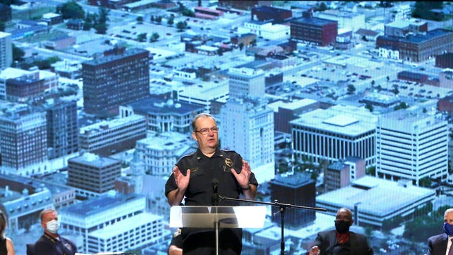 Canton Police Chief Jack Angelo speaks in front of a photo of downtown Canton during the Stark County Collaborative on Race Relations town hall at Faith Family Church in Jackson Township on Tuesday, June 30, 2020.
