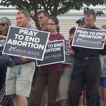 Abortion protesters outside the Planned Parenthood clinic in Iowa City in 2015.