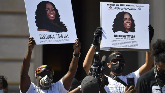 Signs are held up showing Breonna Taylor during a rally in her honor on the steps of  the Kentucky State Capitol in Frankfort, Ky., Thursday, June 25, 2020. The rally was held to demand justice in the death of Taylor who was killed in her apartment by members of the Louisville Metro Police Department on March 13, 2020.