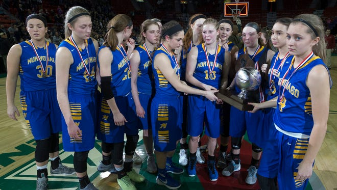 Mukwonago basketball players wear somber faces as they hold the WIAA Division 1 runner-up trophy after falling to Appleton North in the title game on Saturday night at the Resch Center in Ashwaubenon.