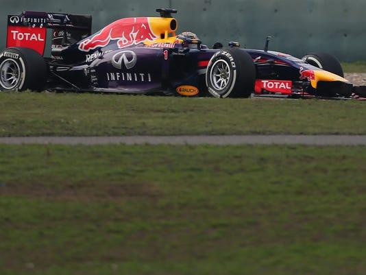 Red Bull Racing driver Sebastian Vettel of Germany drives during the Chinese Formula One Grand Prix at Shanghai International Circuit in Shanghai, Sunday, April 20, 2014. (AP Photo/Eugene Hoshiko)