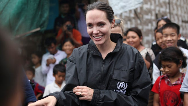 Actress Angelina Jolie Pitt, United Nations High Commissioner for Refugees special envoy and co-founder of the Preventing Sexual Violence Initiative, visits Jan Mai Kaung refugee camp in Myitkyina, Kachin State, Myanmar on July 30, 2015. The little-known Cambodia International Film Festival is getting a star-powered boost this year from Jolie Pitt. The Hollywood star, who is currently in Cambodia filming her latest movie, will serve as president of the festival's honorary committee, organizers said.