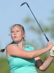 Cooper's Amanda Strickland watches her tee shot at