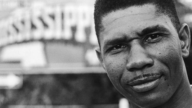 Medgar Evers, the Mississippi NAACP's first field secretary, stands near a state sign in this 1958 photo.