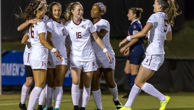The team celebrates with Deyna Castellanos (10) after her first goal as the FSU Soccer team advances to the second round of the NCAA tournament after defeating Ole Miss by a score of 5-0 at the Seminole Soccer Complex in Tallahassee, FL on Nov. 10, 2017.