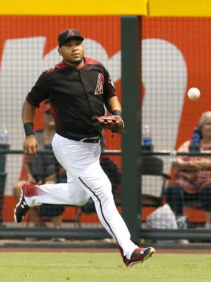 Arizona Diamondbacks left fielder Yasmany Tomas (24) in the first inning during a baseball game against the Milwaukee Brewers, Saturday, Aug. 6, 2016, in Phoenix.