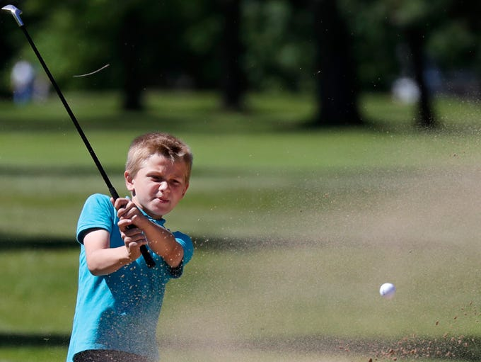 Tyler Bell, 10, hits out of a bunker during the 2018