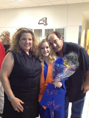 Raina Ferraro is pictured with her parents, Iris and Giulio, in this family photo.