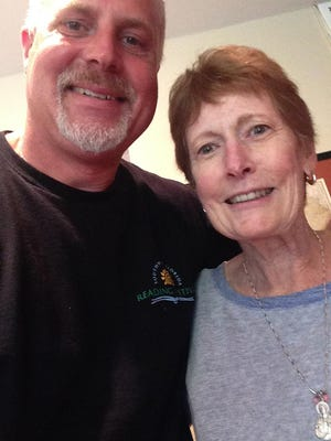 The News-Press sports enterprise reporter David Dorsey, left, and his late mother, Nancy Dorsey, share a love for Kansas basketball. This photo was taken June 14, 51 days before she died from triple negative breast cancer.