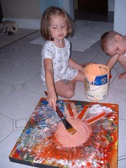 """Marla Olmstead is shown painting in the film """"My Kid Could Paint That"""" in this 2004 file photo."""