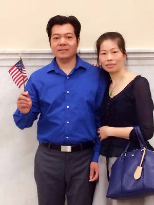 De Tong 'Jerry' Chen and Qiao Xia 'Becky' Yeung, both originally from the People's Republic of China, pose for a picture before Chen was sworn in as an American citizen.