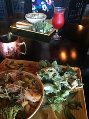 The pesto shrimp pasta at Noodle Zoo was served with a side salad and focaccia bread.