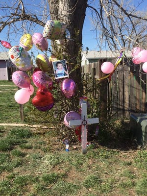 Local residents placed numerous items in memory of Kenzley Olson, 1, who was found dead in Poplar on April 20.