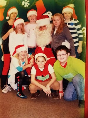 Breakfast With Santa in 2009, when that event used to be held in the elementary school cafeteria, with the Leaders Club from the school serving as elves.