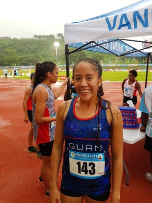 Genina Criss is all smiles after her bronze-medal performance in the women's 1500 meter run Thursday in Port Vila, Vanuatu for the X Pacific Mini Games.