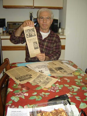 Medal-winning Turkish wrestler Irfan Kaplan shows off newspaper clippings published about him during his career that abruptly ended 31 years ago.