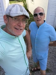 Jim Kelly (left) and Jeff Ayers (wearing a onesy),