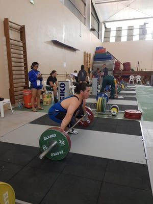 Weightlifter Brandon Holm set new Guam national records in the men's 105 KG division at the Oceania Weightlifting Championships in New Caledonia on June 30.
