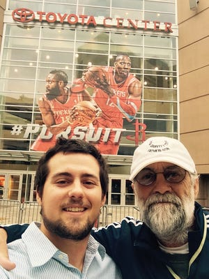 Bill Allen and son Gabe of Moorestown are on a pilgrimage to see an NBA game at each of the league's 29 arenas, including the Wells Fargo Center in Philadelphia, the home of the 76ers. Here they are in Houston, home of the Rockets.