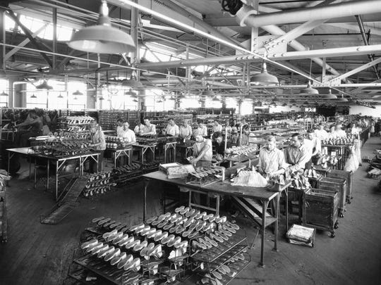 Endicott Johnson workers in one of the company's many factories, around 1930.