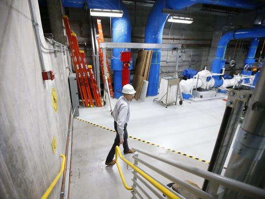 Jim Lodge, NRG Energy vice president and general manager, walks through the underground cooling system near 3rd St. and Washington in Phoenix.