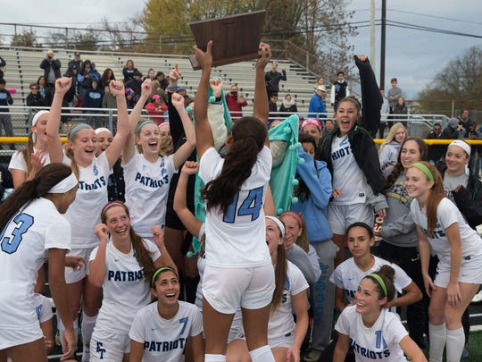 Freehold celebrate their overtime win. Freehold Township Girlsl Soccer defeats East Brunswick 2-1 in overtime for Central Jersey Group IV final in Howell NJ on November 9, 2017.