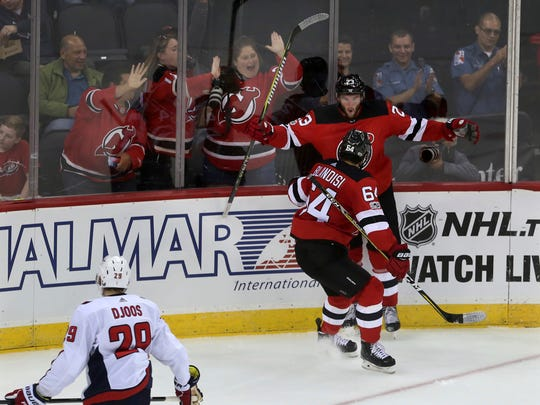 Devils right wing Stefan Noesen (23) celebrates his