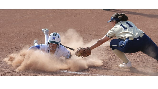 Montwood's Abby Hernandez slides safely into third base as Coronado's Alexis Arcinaiaga tries to make the tag.