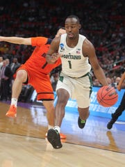 Michigan State guard Joshua Langford drives against Bucknell guard Kimbal Mackenzie during the first of the NCAA tournament Friday, March 16, 2018 at Little Caesars Arena.