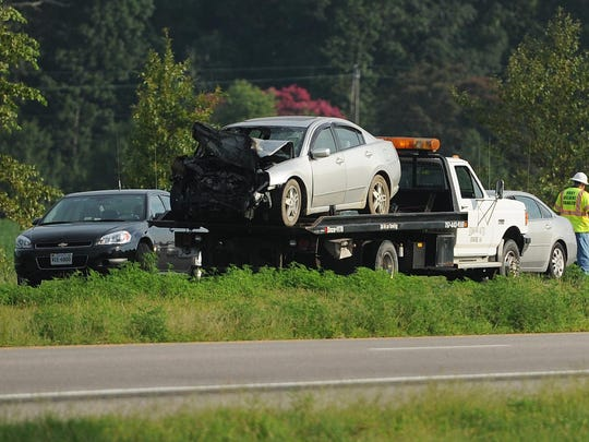 A car involved in a fatal two-vehicle crash is removed from the scene Monday morning, Aug. 18, 2015. The Virginia State Police said one person was killed and another seriously injured on U.S. Route 13 in Eastville, Va.