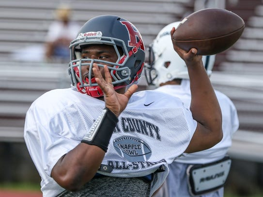 Roselle's Gerald Hairston throws for the Union County