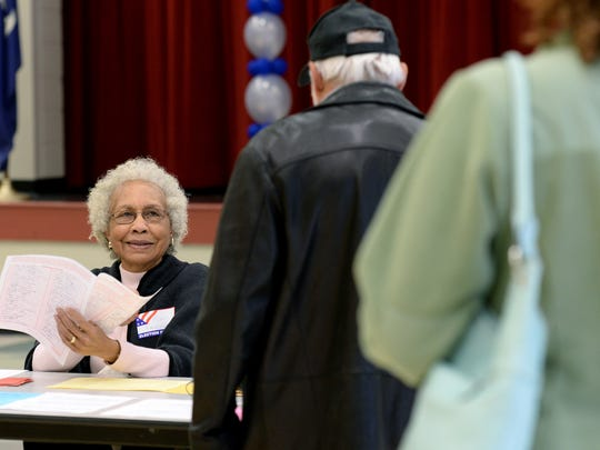 Election official Mary Randolph checks in voters for the Republican primary at Mauldin Middle School Saturday.