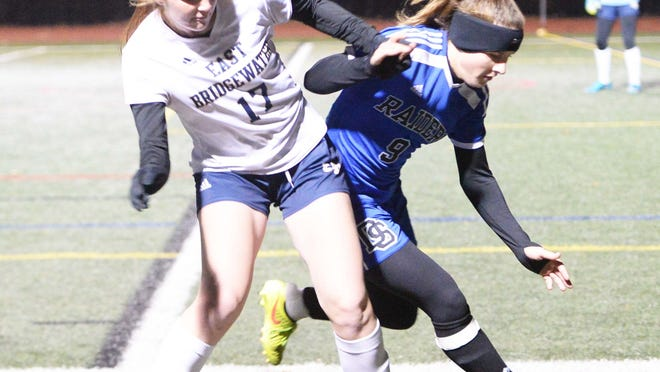 East Bridgewater's Sydney Dewhurst and Dover-Sherborn's Kathryn Mahoney go after a loose ball during the division 3 south sectional final at Norwell High School on Saturday, Nov. 16, 2019.
