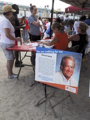 A memorial to Rick Salick greeted participants registering