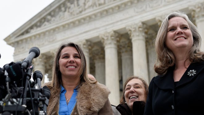 Peggy Young, a Virginia woman who lost her UPS job because she became pregnant, speaks to reporters outside the Supreme Court after her case was heard in December 2014.
