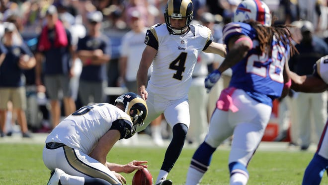 Greg Zuerlein (4) kicks a field goal as punter Johnny Hekker holds during the Rams' loss to the Bills last Sunday.