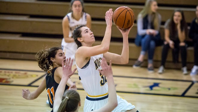Port Huron Northern's Bree Bauer goes for a layup Friday, Feb. 10, 2017 at Port Huron Northern High School.