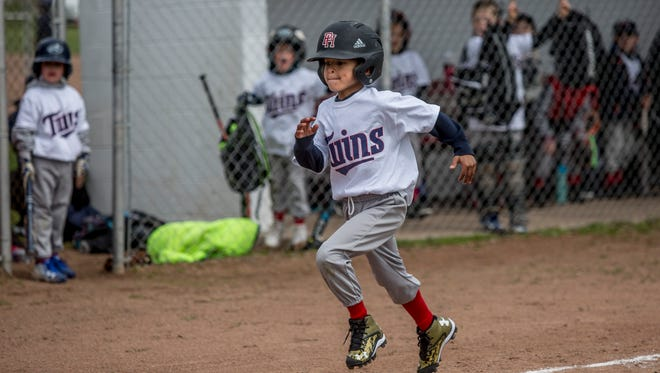 Port Huron Twins' Joey Lincoln, 8, runs home after hitting a home run during a game Saturday, April 29, 2017 at the Port Huron Little League Park.