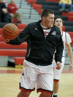 Hilton senior Nick Walsh, a football lineman, also has played on the Unified basketball team and joined the boys varsity basketball team for the first time this winter, in part, because how well he looked and  moved in the Unified season.