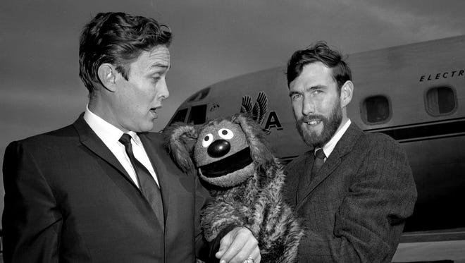 "Country music singer Jimmy Dean gets some tongue-in-cheek comment from his sidekick, Rowlf, celebrated dog of ""The Jimmy Dean Show"" and Rowlf's manager, and voice, Jim Henson. They arrived at Berry Field to tape the ABC network television show from the Opry House."