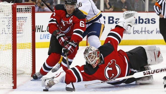 Devils goalie Keith Kinkaid (1) dives to make a save on a shot by Predators forward James Neal (18) as Devils defenseman Andy Greene (6) helps out in the first period Tuesday