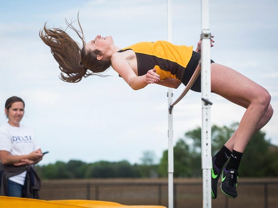 Monroe Central's Miranda Haney does the high jump in