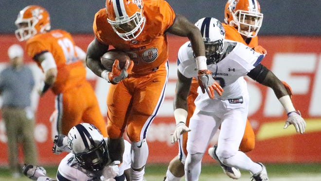 UTEP running back Aaron Jones, 29, is snagged at the foot by Old Dominion's TJ Ricks during second half action Saturday night in the Sun Bowl.