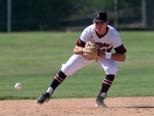 La Quinta's Trenton Schwanke stops a ground ball from