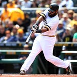 Pittsburgh Pirates first baseman Pedro Alvarez (24) hits a solo home run against the Milwaukee Brewers during the second inning at PNC Park.