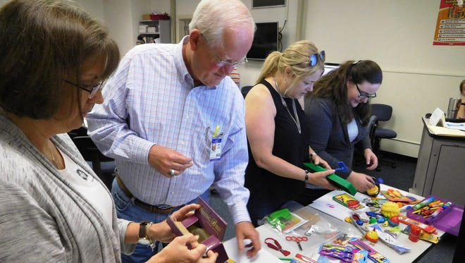 Teachers browse examples of assistive technology which are products or tools that improve the functional capabilities of individuals with disabilities.