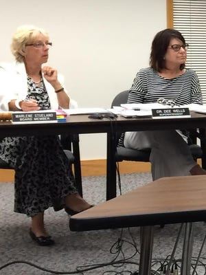 Marshfield School Board President Marlene Stueland, left, and Superintendent Dee Wells, right, at a board meeting in 2015.